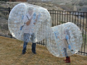 People Playing in Bubble Balls