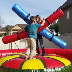 2 kids with inflatable jousting