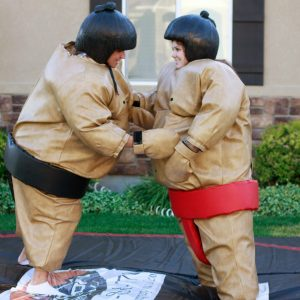 2 kids in Sumo Wrestling inflatable suits
